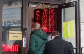 A digital board displaying currency exchange rates in Moscow on March 18, 2020.