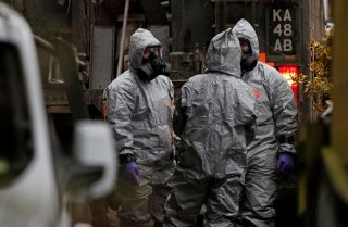British military personnel wear protective clothing while investigating the poisoning of two people in England.