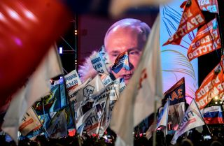 Russian President Vladimir Putin gives a speech at a rally March 18 to commemorate the fourth anniversary of his country's annexation of Crimea.