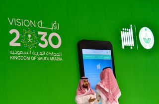 A display promotes Saudi Arabia's Vision 2030 economic reform campaign at the 2017 GITEX technology exhibition in Dubai, United Arab Emirates.