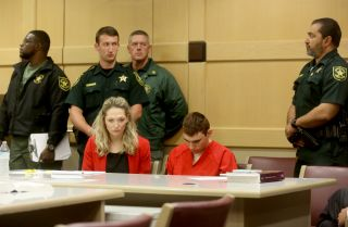 Nikolas Cruz sits in court during a hearing. He is charged with killing 17 people in a school shooting on Feb. 14.