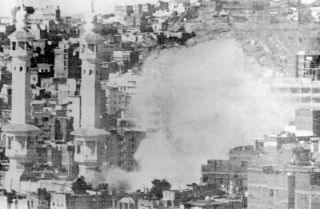 "Mecca's Grand Mosque burns in November 1979 during a siege by several hundred Muslim militants seeking to overthrow the House of Saud. The two-week siege moved the Saudi royal family to counter claims it was not ""Islamic enough"" by fostering an even closer relationship with Wahhabi clerics and their followers."