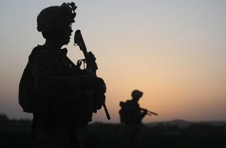 U.S. Marines with the 2nd Marine Expeditionary Brigade, RCT 2nd Battalion 8th Marines Echo Co. step off in the early morning during an operation to push out Taliban fighters on July 18, 2009 in Herati, Afghanistan . The Marines met no resistance during the operatoin. The Marines are part of Operation Khanjari which was launched to take areas in the Southern Helmand Province that Taliban fighters are using as a resupply route and to help the local Afghan population prepare for the upcoming presidential elect