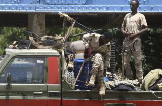 This photo shows members of the Sudanese Rapid Support Forces on patrol in Khartoum