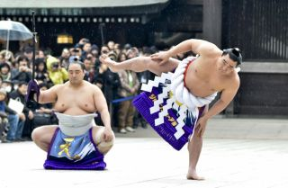 Mongolian-born Harumafuji Kohei (r) is one of only 72 sumo wrestlers in the centuries-old history of the sport to attain the rank of yokozuna, or grand champion.