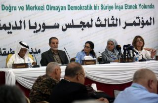 The Syrian Democratic Council, including Kurdish officials and some members of Syria's domestic opposition, gather in the northern town of Tabqa during July 2018.