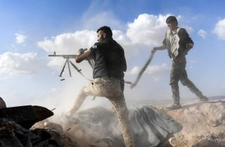Syrian loyalist fighters advance on rebel-held territory in Idlib province in November 2017.