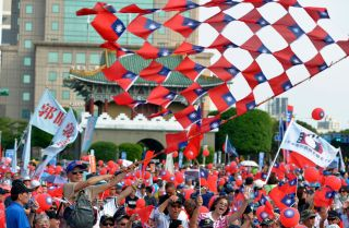 Supporters of Taiwanese mayoral candidate Ting Shou-chung