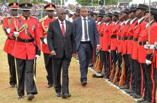 Tanzanian President John Magufuli reviews an honor guard on Dec. 9, 2017, as he attends a ceremony marking the 56th anniversary of his country's independence.