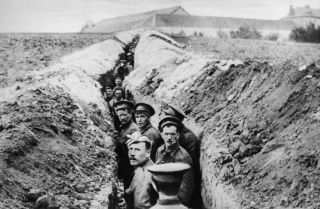 British soldiers in an early trench on the Western Front, October 1914.