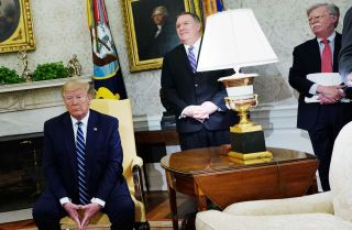 U.S. President Donald Trump, Secretary of State Mike Pompeo and national security adviser John Bolton, left to right, are pictured in the Oval Office of the White House on June 20, 2019.
