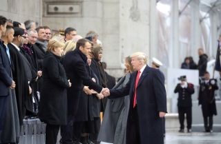 U.S. President Donald Trump greets French President Emmanuel Macron in Paris on Nov. 11, 2018, during commemorations marking the 100th anniversary of the end of World War I.