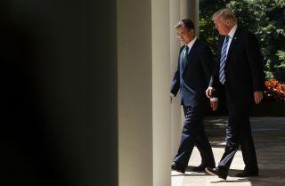 South Korean President Moon Jae In walks beside U.S. President Donald Trump at the White House in June 2017.