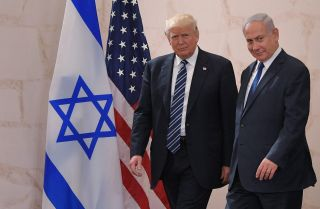 Israeli Prime Minister Benjamin Netanyahu (R) and U.S. President Donald Trump arrive at the Israel Museum in Jerusalem in May 2017.
