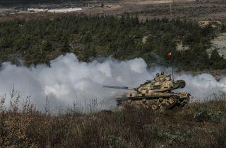 Turkish armored vehicles train near Idlib on the Turkish border with Syria.