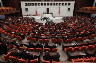 Members of Turkey's parliament pass legislation approving a deployment of Turkish troops to Libya on Jan. 2, 2020.