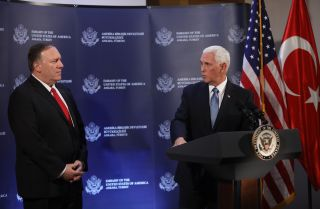 U.S. Secretary of State Mike Pompeo, left, and U.S. Vice President Mike Pence hold a news conference at the U.S. Embassy in Ankara, Turkey, on Oct. 17, 2019.