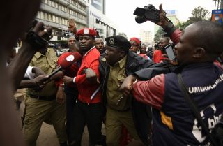 Police detain musician-turned-politician Robert Kyagulanyi Ssentamu – also known as Bobi Wine - during a demonstration on July 11, 2018, in Kampala.