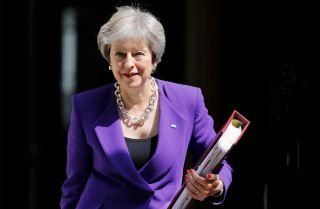 British Prime Minister Theresa May leaves 10 Downing Street on July 4 ahead of a session in the House of Commons.