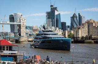 Billionaire Joe Lewis' nearly 100-meter luxury yacht floats in Butler's Wharf in London in July 2018.