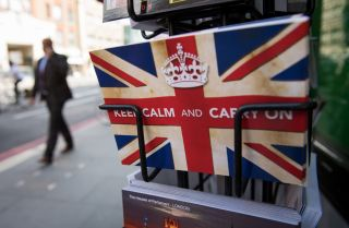 """Postcards featuring the World War II British slogan """"Keep Calm and Carry On"""" are seen in London on June 24, 2016."""