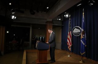 U.S. Deputy Attorney General Rod Rosenstein announces the indictments of 13 Russians and three Russian entities accused of meddling in the 2016 presidential election during a Feb. 16 news conference in Washington.