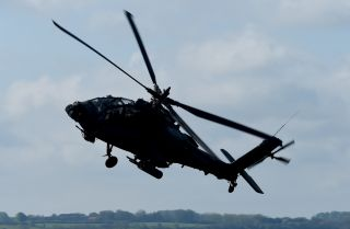 "An image of a combat helicopter, type ""Apache,"" of the U.S. Army."
