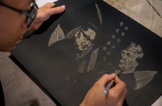 This photo shows a Vietnamese artist creating a portrait showing North Korean leader Kim Jong Un and U.S. President Donald Trump, who are meeting in Hanoi.