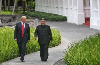 In this photograph, U.S. President Donald Trump (left) and North Korean leader Kim Jong Un are shown during their Singapore summit on June 12, 2018.