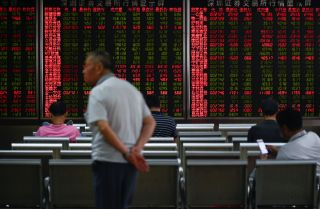 Chinese investors watch a stock ticker at a Beijing securities company on Aug. 26.