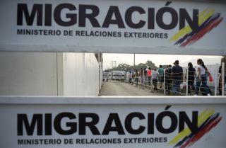 People queue at the border between Colombia and Venezuela