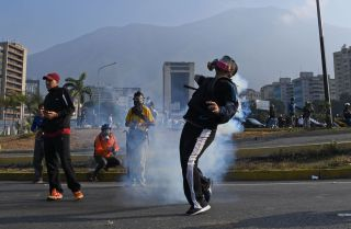 Opposition supporters clash with Venezuelan security forces in Caracas on April 30, 2019.
