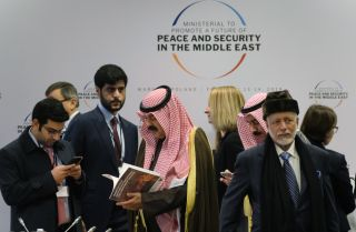 Participants arrive for the opening session of a Middle East security conference held in Warsaw, Poland, on Feb. 14, 2019.
