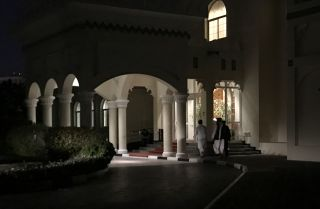 Members of the Taliban negotiating team enter the venue in Doha