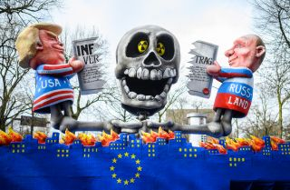 A parade float in Dusseldorf, Germany, on March 4, 2019, features effigies of U.S. President Donald Trump and Russian President Vladimir Putin.