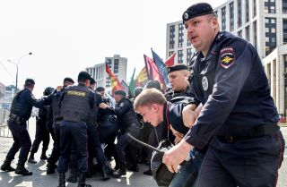 Russian riot police restrain a protester at a demonstration in Moscow in May over the Kremlin's decision to ban the messaging app Telegram.