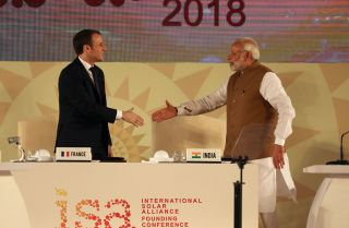French President Emmanuel Macron, left, and Indian Prime Minister Narendra Modi shake hands at the first conference of the International Solar Alliance, a cooperative effort their countries launched in 2015.