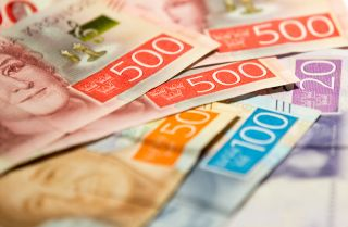This photo illustration displays Swedish krona banknotes.