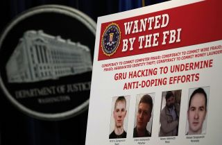 An FBI 'Wanted' poster shows several members of the Russian military intelligence service on Oct. 4, 2018