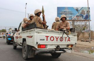 This photo shows Yemeni separatist fighters being carried in the back of a civilian pickup truck in the city of Aden.