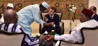 Chad's president Idriss Deby Itno (2nd L) speaks with French President Emmanuel Macron (C) as they gather with President of Burkina Faso Roch Marc Christian Kabore (front L), Mali's President Ibrahim Boubacar Keita (rear L), Niger's President Mahamadou Issoufou (front R) and Mauritanian President Mohamed Ould Abdel Aziz (rear R) for a meeting during the G5 Sahel summit in Bamako, July 2.