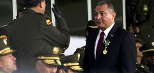 Mexican Secretary of Public Safety Genaro Garcia Luna, right, in Bogota, Colombia, on May 19, 2011.