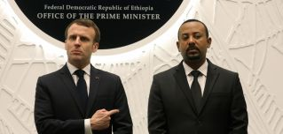 Ethiopian Prime Minister Abiy Ahmed (R) speaks with French President Emmanuel Macron after signing agreements during a meeting on March 12, 2019, in Addis Ababa.