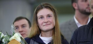 Russia's Maria Butina arrives at Moscow's Sheremetyevo International Airport on Oct. 26, 2019, after her deportation from the United States for failing to register as a foreign agent.