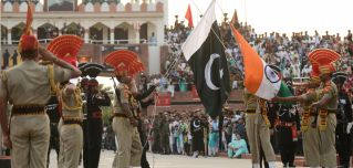 Indian and Pakistani guards take part in a ceremony at their shared border marking the changing of the guard.