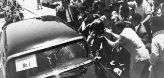 Venezuelans attack the limousine of Vice President Richard Nixon on May 13, 1958, in Caracas.