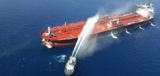 The Norwegian-owned Front Altair oil tanker burns after being attacked in the Gulf of Oman on June 13, 2019.