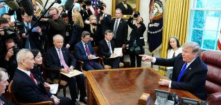 U.S. President Donald Trump takes part in a meeting with China's Vice Premier Liu He (L) in the Oval Office of the White House on Feb. 22.
