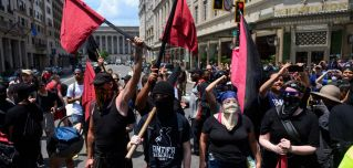 "Members of an antifa group march as the Alt-Right movement gathers for a ""Demand Free Speech"" rally in July 6, 2019, Washington."