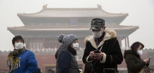 Chinese tourists wear masks to protect themselves from pollution outside the Forbidden City in Beijing.